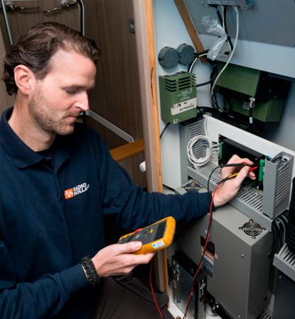 Radio Holland Technician checking equipment
