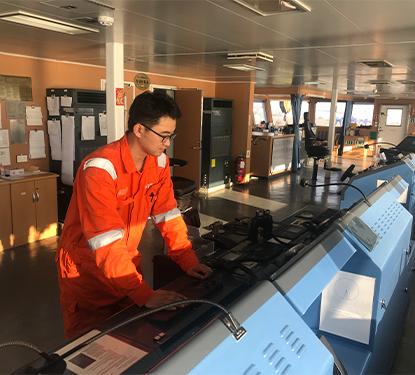 Service Technician working on board of a vessel