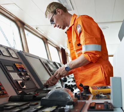 Service Technician at work on bridge console