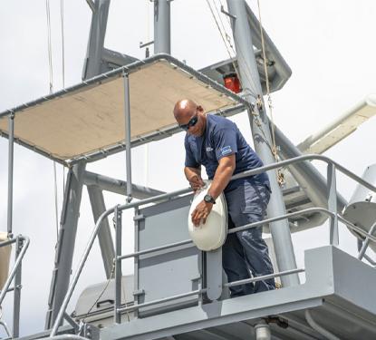 Radio Holland Technician servicing Coastguard vessel on Curacao